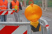 Orange Lamp In A Roadworks In The City