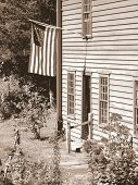 old country home with flag