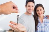 Man with his wife being given a house key