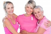 stock photo of  breasts  - Women wearing pink tops and ribbons for breast cancer on white background - JPG