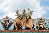 foto of durga  - Statue of goddess Durga on her vehicle lion on Hindu temple Matale Sri Muttu Mariyamman Sri Lanka - JPG