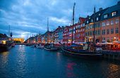 COPENHAGEN, DENMARK - AUGUST 25: unidentified people enjoying evening in open cafes of the Nyhavn on August 25, 2010 in Copenhagen, Denmark.Nyhavn district is most famous landmark of Copenhagen.