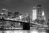 picture of bridge  - New York City Brooklyn Bridge black and white with downtown skyline over East River - JPG
