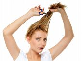 Unhappy Woman Cutting Her Hair With Scissors