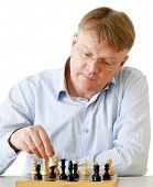 Man playing chess, isolated on white background