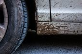 foto of taint  - detail of a car wheel and some mud tainting the car - JPG