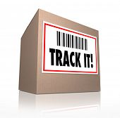 stock photo of shipping receiving  - The words Track It with barcode on a package shipment label to trace the shipment of a cardboard box shipped in the mail or by courier - JPG