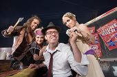 foto of gullible  - Naive businessman giving money to group of fortune tellers - JPG