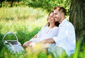 pic of amor  - Beautiful Young Couple Having Picnic in Countryside - JPG