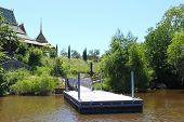 stock photo of dock a pond  - Dock at the lake - JPG
