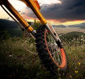 stock photo of dirt-bike  - details of dirt bike in high mountain peak - JPG