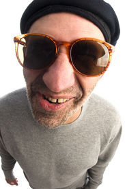 image of honkers  - senior middle age man funny face twisted mouth wearing artist french hippie beret hat macro close up distorted large nose - JPG