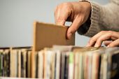 foto of thrift store  - Close Up On Hands Browsing Record Store