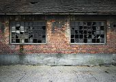 brick wall with broken windows
