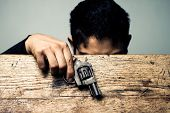 stock photo of mayhem  - Student At School Desk With Gun Detail