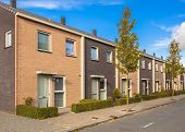 stock photo of middle class  - Modern Street with Terraced Houses in Suburban Neighborhood - JPG