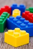 Color Plastic  Blocks On Wooden Background