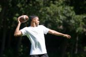 Man Throwing A Football