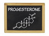 chemical formula of progesterone on a blackboard