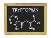 chemical formula of tryptophan on a blackboard