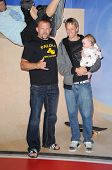 Chuck Liddell with Tony Hawk and his daughter Kadence at the Unveiling of Madame Tussauds Wax Figure of Tony Hawk. Madame Tussauds Wax Museum, Hollywood, CA. 07-29-09