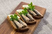 Sprats Lying On Pumpernickel Bread