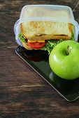 sandwich with cheese and tomato and green apple for a healthy  lunch