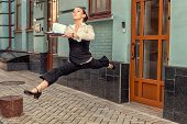 foto of souse  - Woman runner running rush to carry documents to the office - JPG