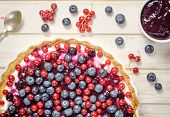 image of tarts  - Fresh berries on the tart cake from above - JPG