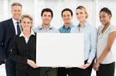 Group Of Happy Multi Ethnic Businesspeople Holding Blank Placard
