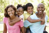 image of pacific islander ethnicity  - Family portrait in park - JPG