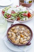 Broad beans in a bowl and greek sald, Greece