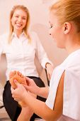 Therapist's Hands Massaging Female Foot
