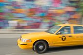 Fast Taxi On The Street With Colors Wall