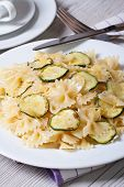 Farfalle Pasta With Zucchini Closeup With Knife And Fork