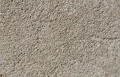 stock photo of homogeneous  - strong homogeneous texture of artificial stone wall - JPG