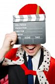 Man with movie clapboard isolated on white