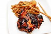 Barbequed Chicken Thigh Served With Rice Noodles And Veggies