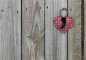 Key to my heart; red checkered (plaid) heart with iron keys hanging on rustic wooden door