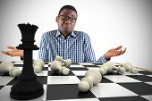 Composite image of young businessman shrugging shoulders with chessboard