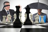 Composite image of businessmen with chessboard against white background with vignette