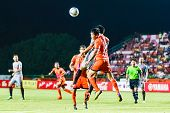 Sisaket Thailand-june 29: Chatchai Mokkasem Of Sisaket Fc. (orange) In Action During Thai Premier Le