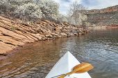 springtime canoe paddling - canoe bow with a paddle on Horsetooth Reservoir near Fort Collins, Color