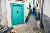 White Walls And Green Door. Medina, Old Part Of Tangier, Morocco
