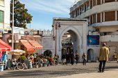 Tangier, Morocco - March 23, 2014: Ancient Gate To Medina Of Tangier, Morocco. Ordinary People Walki