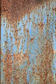 Rusty Metal With Peeling Blue Paint