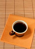 One Cup Of Coffee On A Yellow Napkin
