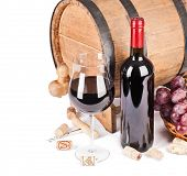 Wine in glass with a barrel isolated on white