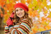 Portrait Of Beautiful Attractive Stylish Young Woman In Red Beret In Autumn Park