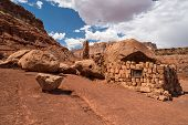 image of cliffs  - Native American home in Cliff Dwellers located in Northern Arizona at Marble Canyon and at the foot of Vermillion Cliffs is known for its unique shaped boulders and rugged terrain - JPG